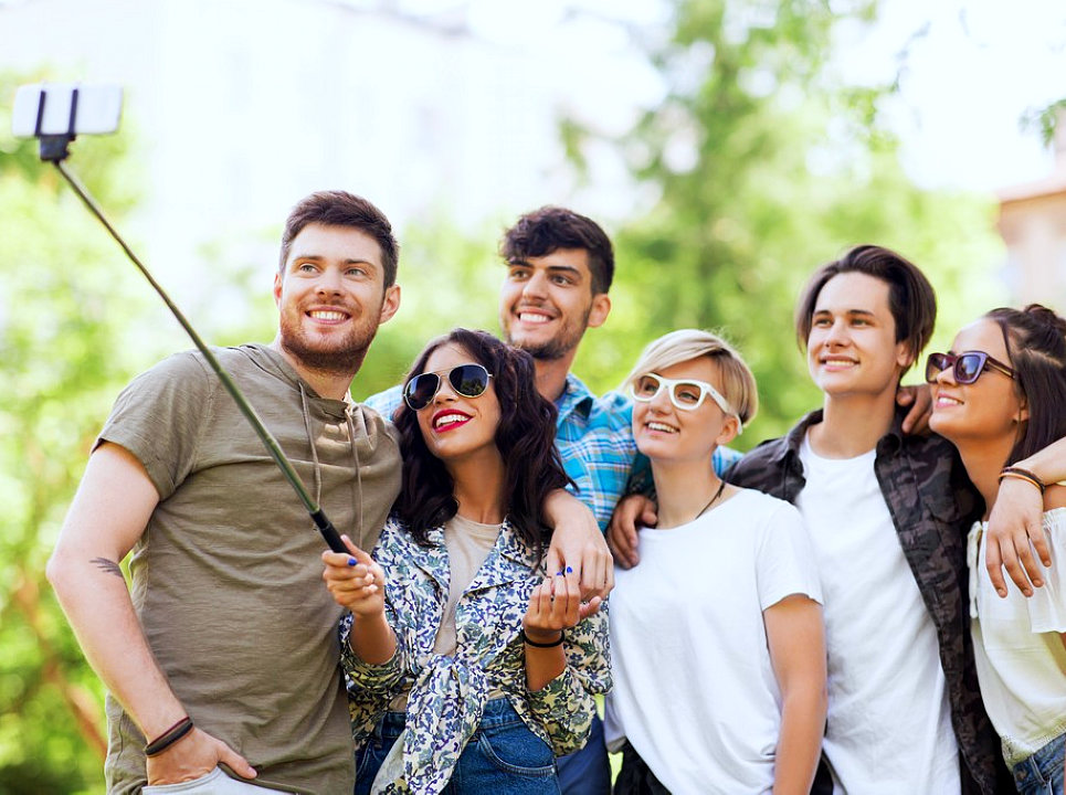 a group of people doing selfie