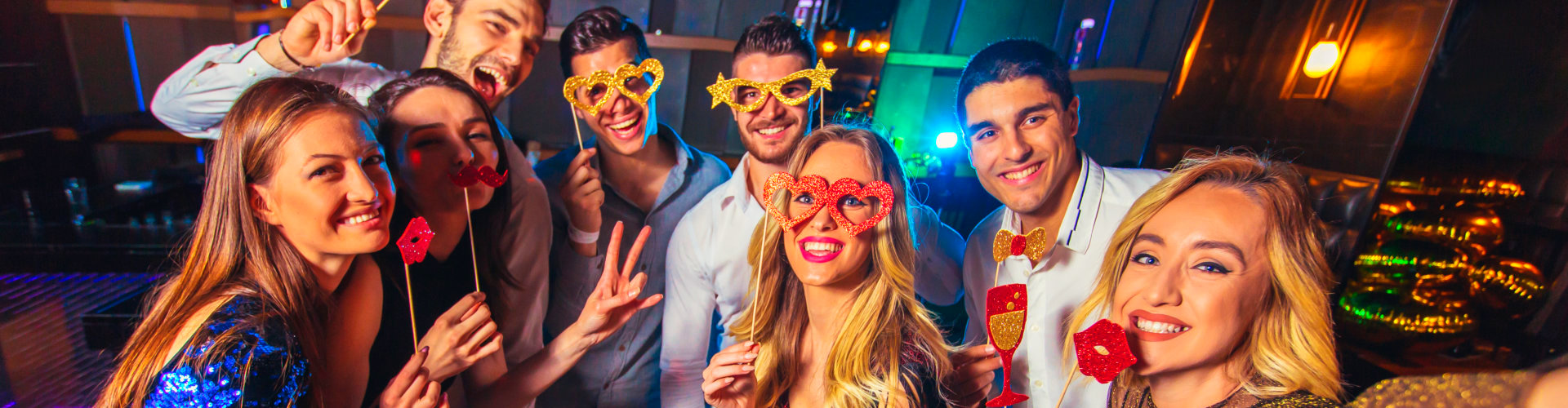 a group of people in a party doing selfie